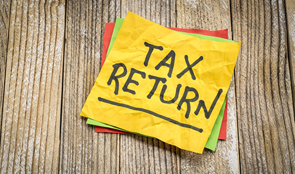 What penalties can I expect for a late tax return?